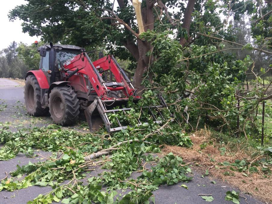 A tractor works to clear a tree in Mayfield Road on Sunday afternoon.